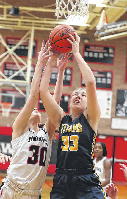Shawnee's Kelly Cooper (30) and Ottawa-Glandorf's Erin Kaufman (33) during Thursday night's game at Shawnee.