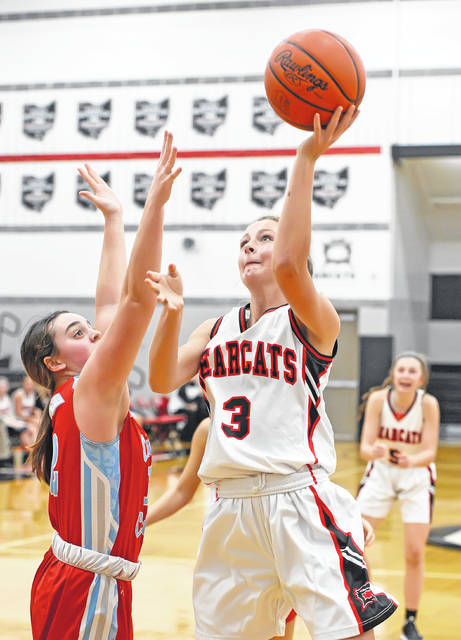 Spencerville's Kirsten Wurst goes up strong against Lima Central Cathoic's Bridget Mulcahy during Monday's game at Spencerville High School.
