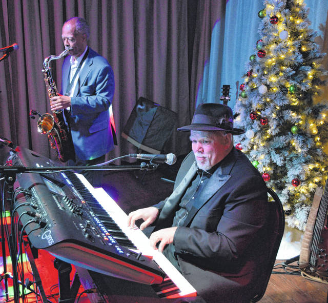 Chuck Summers and Frank Harnishfeger play for an intimate crowd at Old City Prime's Upper Lounge, Saturday night.