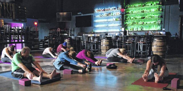 On Sunday, Vino Bellissimo hosted a yoga class. Particiapnts earned a glass of wine after it's over.