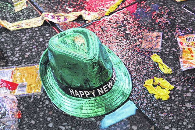 "A ""Happy New Year"" hat lies on the wet ground along with other items following the celebration in New York's Times Square. Setting a New Year's resolution about improving your finances is an excellent way to start 2021. But before you come up with a list of goals, be aware that there are a few you should avoid."