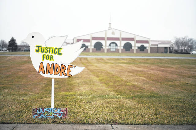 """Signs reading """"Justice for Andre'"""" and """"Justice for Casey,"""" in reference to Andre' Hill and Casey Goodson Jr., both Black men killed at the hands of law enforcement in Columbus, sit outside the First Church of God before the funeral of Andre Hill on Tuesday, Jan. 5, 2021 in Columbus, Ohio. Hill, a 47-year-old Black man, was shot and killed by Columbus Division of Police Officer Adam Coy in the early morning of Dec. 22, 2020 after officers responded to a non-emergency call in the area."""