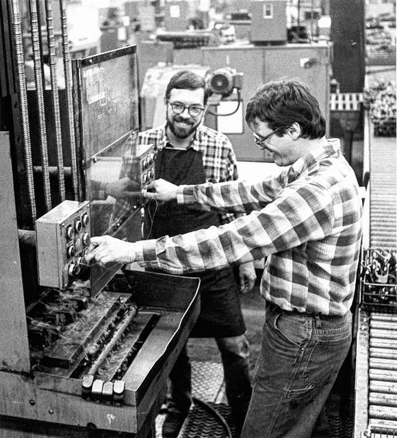 Unidentified men work at Lima's Dana Corp. in this photo from 1987.