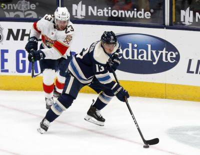 Blue Jackets forward Cam Atkinson, right, controls the puck in front of Florida Panthers forward Carter Verhaeghe during Tuesday night's game in Columbus (AP photo)