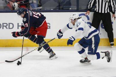 Columbus Blue Jackets' Liam Foudy, left, and Tampa Bay Lightning's Ryan McDonagh chase the puck during Thursday night's game in Columbus. (AP photo)