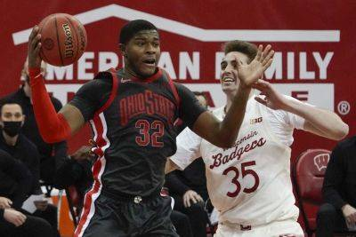 Ohio State's E.J. Liddell gets a rebound against Wisconsin's Nate Reuvers during Saturday's game in Madison, Wis. (AP photo)
