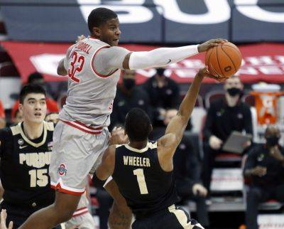 Ohio State's E.J. Liddell blocks a shot by Purdue's Aaron Wheeler during Tuesday night's game in Columbus. (AP photo)