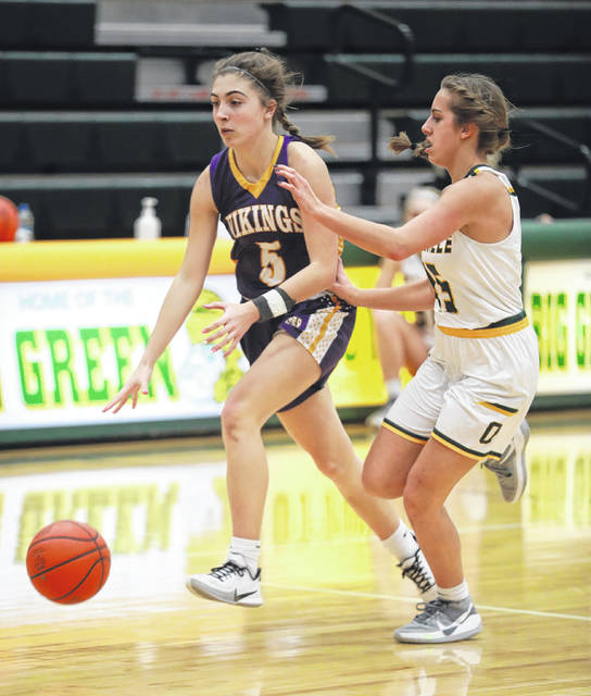 Leipsic's Ava Henry drives against Ottoville's Skylar Turnwald during Saturday's game at Ottoville.