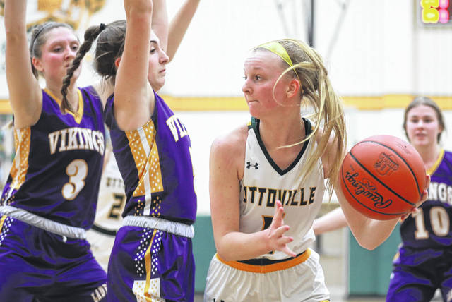 Leipsic's Elizabeth Scheckelhoff (3) and Ava Henry guard Ottoville's Alexa Honigford during Saturday's game at Ottoville.