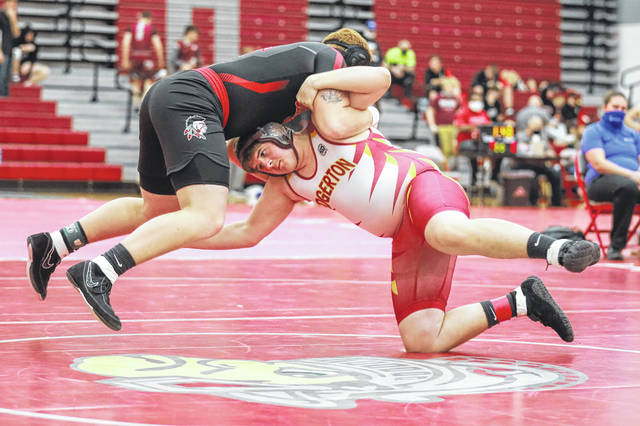 Shawnee's Michael Keysor goes airborne against Edgerton's Justin Huffman of Edgerton at 220 pounds during Saturday's Spartan Invitational at Lima Senior.
