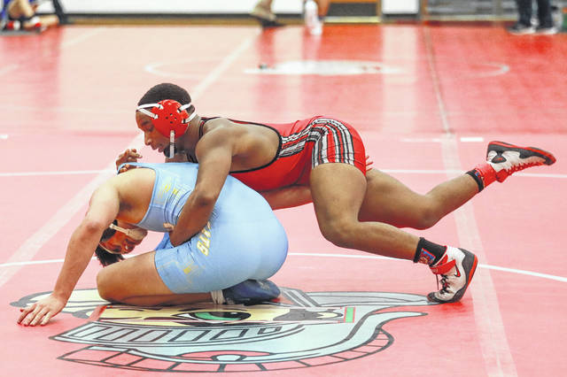 Lima Senior's Davion Browning, right, competes against Bath's Devin Anspach at 182 pounds during Saturday's Spartan Invitational at Lima Senior.