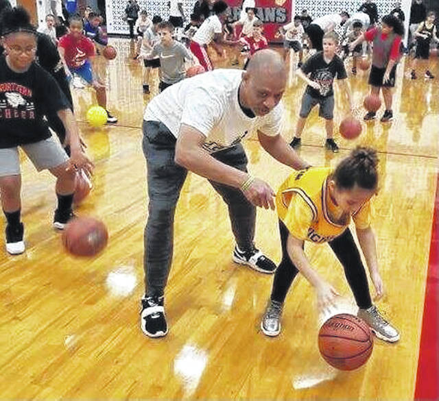"""Greg """"Radar"""" Williamson works with K.J. Hood at a Lima youth clinic."""