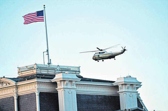 Marine One with US President Donald Trump and First Lady Melania Trump aboard departs the White House in Washington, DC, en route Joint Base Andrews, Maryland on Jan. 20, 2021. President Trump and the First Lady travel to their Mar-a-Lago golf club residence in Palm Beach, Florida, and will not attend the inauguration for President-elect Joe Biden. (Patrick T. Fallon/AFP/Getty Images/TNS)