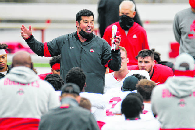 Ohio State football coach Ryan Day talks to his team during a practice last season. Day said Wednesday he hopes the Buckeyes can begin spring practice in mid-March and play a spring game.