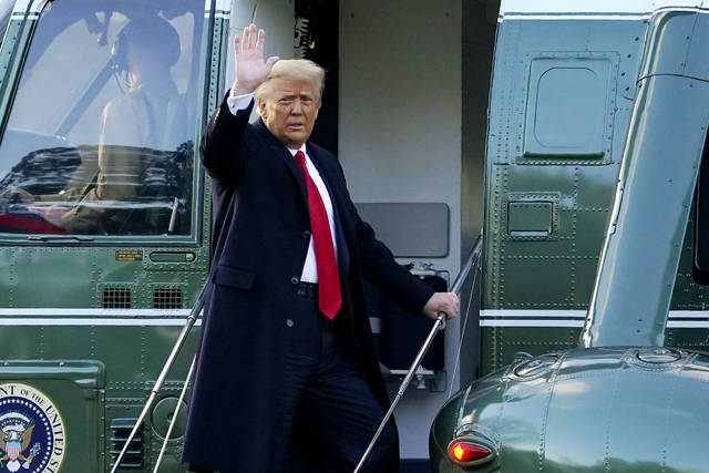FILE - In this Wednesday, Jan. 20, 2021, file photo, President Donald Trump waves as he boards Marine One on the South Lawn of the White House, in Washington, en route to his Mar-a-Lago Florida Resort. Former President Trump has named two lawyers to his impeachment defense team, one day after it was revealed that the former president had parted ways with an earlier set of attorneys. (AP Photo/Alex Brandon, File)
