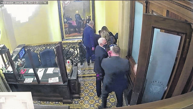 In this image from video, a security video shows Vice President Mike Pence being evacuated as rioters breach the Capitol, as House impeachment manager Del. Stacey Plaskett, D-Virgin Islands, speaks during the second impeachment trial of former President Donald Trump in the Senate at the U.S. Capitol in Washington on Wednesday.