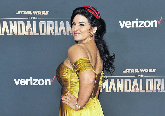"""Gina Carano attends the 2019 LA premiere of """"The Mandalorian"""" at the El Capitan Theatre in Los Angeles. In a statement Wednesday, Lucasfilm said Carano is no longer a part of """"The Mandalorian"""" cast after many online called for her firing over a social media post that likened the experience of Jews during the Holocaust to the U.S. political climate."""