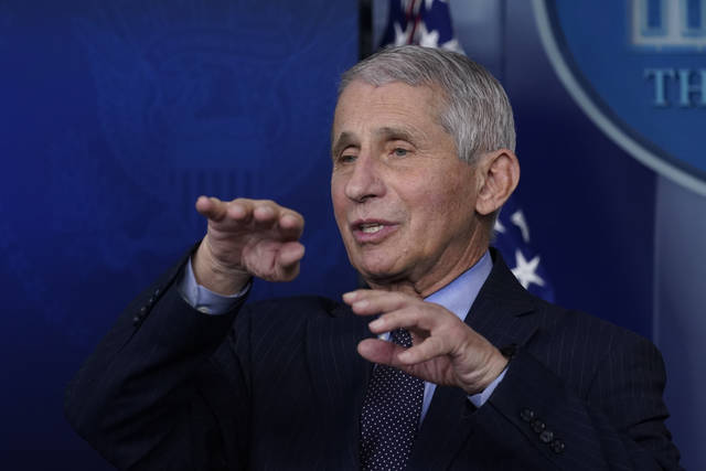 """Dr. Anthony Fauci, director of the National Institute of Allergy and Infectious Diseases, speaks with reporters Jan. 21 at the White House. On CNN's """"State of the Union"""" on Sunday, Fauci said, """"It's nothing like we have ever been through in the last 102 years, since the 1918 influenza pandemic."""""""