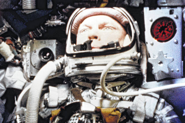 """FILE - In this Feb. 20, 1962, file photo, provided by NASA, astronaut John Glenn pilots the """"Friendship 7"""" Mercury spacecraft during his historic flight as the first American to orbit the Earth. Fans of the late astronaut are working to bring a statue of his likeness to the Ohio Statehouse to mark major future milestones, such as his birthday and the anniversary of his famous space flight. Thursday marks 58 years since Glenn became the first American to orbit the Earth, making him an instant national hero in 1962."""