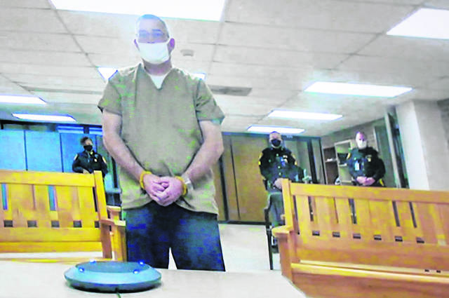 Former Columbus police officer Adam Coy is seen remotely on television during his initial appearance on Friday, Feb. 5, 2021, at the Franklin County Common Pleas Courthouse in Columbus, Ohio. Coy was arraigned on four charges in the December 2020 police shooting death of Andre Hill, a Black man.