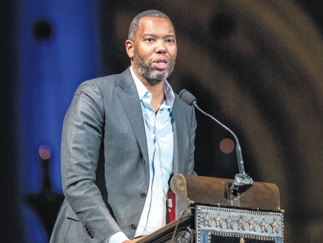 "FILE - Author Ta-Nehisi Coates speaks during the Celebration of the Life of Toni Morrison in New York on Nov. 21, 2019. Coates, the acclaimed essayist and novelist who expanded the world of Wakanda in Marvel comics, will write the script for a new ""Superman"" film from Warner Bros. The studio announced Friday that Coates will pen the screenplay for an upcoming ""Superman"" film that's early in development."