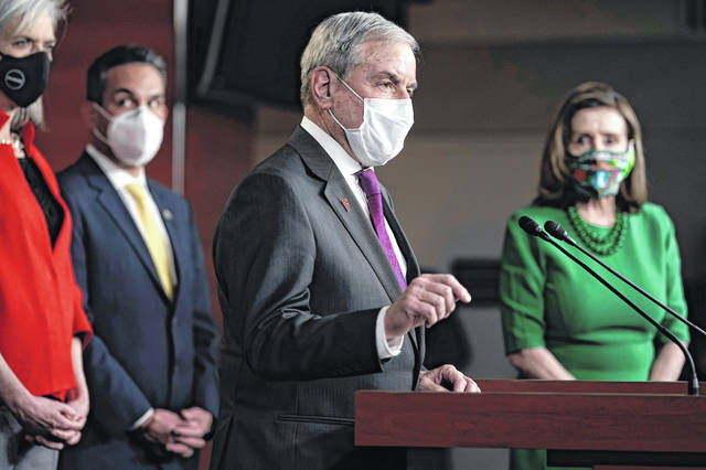 House Budget Committee Chairman John Yarmuth, D-Ky., speaks meets with reporters before the House votes to pass a $1.9 trillion pandemic relief package, during a news conference at the Capitol in Washington, Friday, Feb. 26, 2021. House Speaker Nancy Pelosi of Calif., is at right.