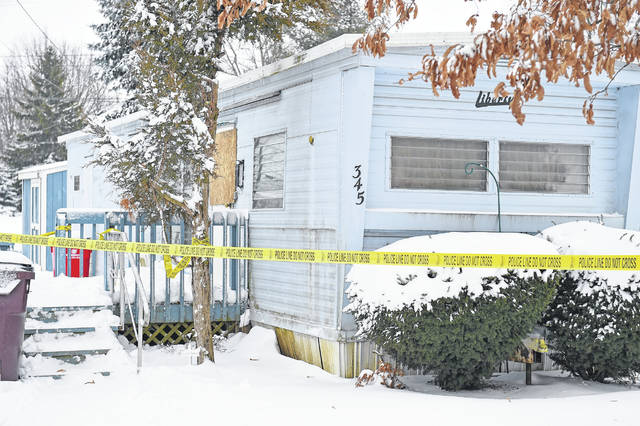 Police tape marks off the house trailer at 345 W. Montford, Ada. The Ada Police Department responded to a disturbance involving a knife early Monday morning that left a Lima man dead.