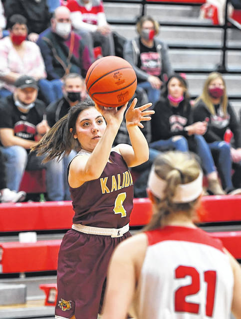 Kalida's Kathryn Siebeneck puts up a shot during Saturday night's Division IV district final against Columbus Grove at Van Wert.