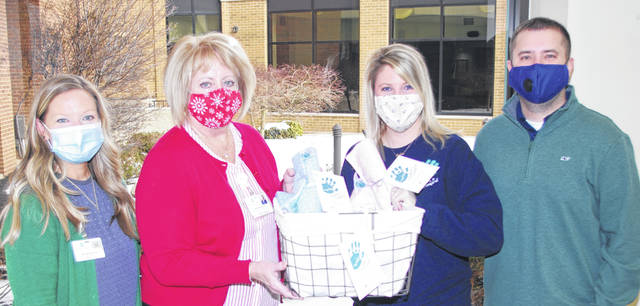 Pictured L to R: Amy Becker, Linda Haines of Grand Lake Health System and Megan and Thomas Leidy of Carter's Comfort.