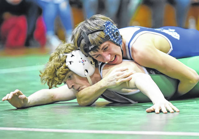 St. Marys' Michael Crites, top, wrestles Celina's Landin Wallace during Tuesday night's Western Buckeye League dual match at Celina.
