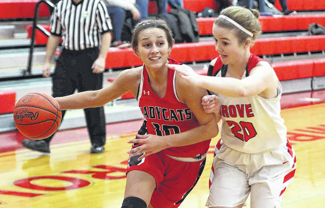 Delphos Jefferson's Kaylee Buzard drives against Columbus Grove's Shay Schroeder during Thursday night's game at Columbus Grove. See more game photos at LimaScores.com.
