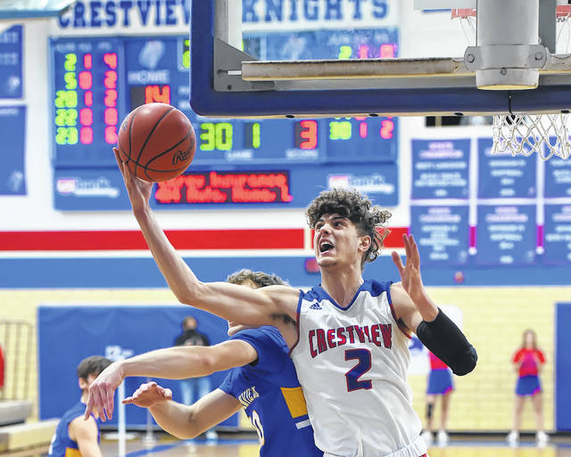 Crestview's Kalen Etzler pulls down a rebound against Lincolnview's Carson Fox during Friday night's game at Crestview. See more game photos at LimaScores.com.