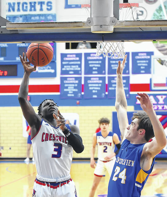 Crestview's Rontae Jackson puts up a shot against Lincolnview's Daegan Hatfield during Friday night's game at Crestview.