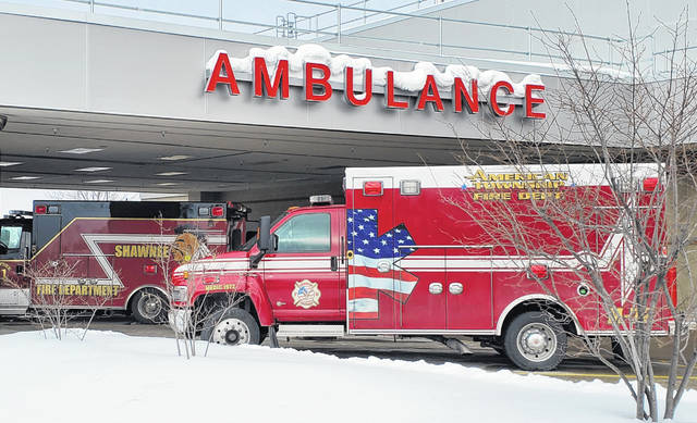 Ambulances from Shawnee Township Fire Department, left, and American Township Fire Department wait to depart from Mercy Health-St. Rita's Medical Center on Friday morning. Ambulances at departments around the region will receive upgraded heart technology thanks to a donation from the hospital.