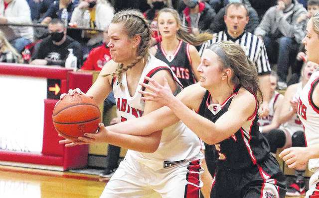 Spencerville's Gabi Croft, right, tries to get the ball away from Delphos Jefferson's Lauren French during Thursday night's game at Delphos Jefferson Middle School. See more game photos at LimaScores.com.
