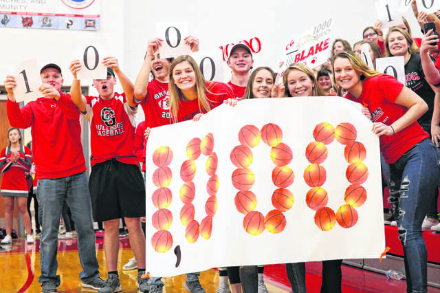 Columbus Grove students celebrated when Blake Reynolds reached 1,000 points in his varsity basketball career during a game against Delphos Jefferson last season.