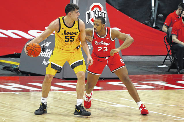 Iowa's Luka Garza, left, posts up against Ohio State's Zed Key during the Hawkeyes' 73-57 win over the Buckeyes on Sunday. Garza had 24 points and 10 rebounds.
