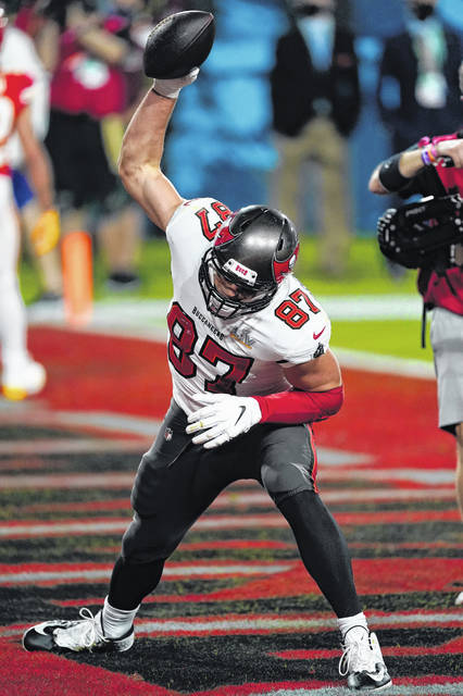 Tampa Bay Buccaneers tight end Rob Gronkowski (87) celebrates after a catch for a touchdown during the NFL Super Bowl 55 football game against the Kansas City Chiefs, Sunday, Feb. 7, 2021 in Tampa, Fla. (AP Photo/Doug Benc)