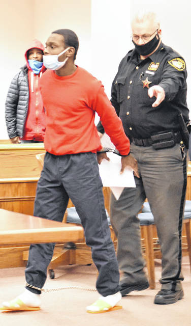 Ja'naz Smith, 16, left a Lima courtroom in leg irons and handcuffs Wednesday following a brief appearance during which he waived his constitutional right to a speedy trial on a charge of murder. Smith is accused in the shooting death of Danielle Jackson more than a year ago outside Pappy's Bar in Lima.