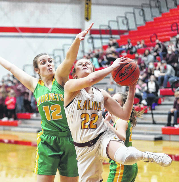 Kalida's Brenna Smith puts up a shot against Cory-Rawson's Mackenzie Cascaden during a Thursday night Division IV girls district semifinal at Van Wert.