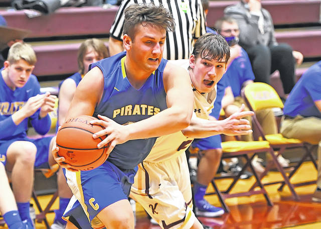 Continental's Bryce Recker grabs a loose ball against Kalida's Jayce Horstman during Tuesday night's Division IV sectional semifinal at Kalida High School.