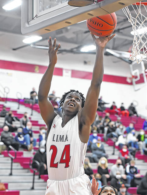 Lima Senior's Quan Moore puts up a shot during Friday night's game against Toledo St. John's at Lima Senior.