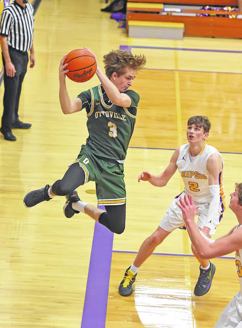 Ottoville's Trae Schlagbaum keeps the ball in play against during Saturday night's game at Leipsic.