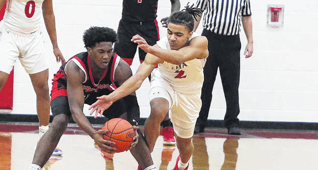 Lima Senior's Jareon Mayo attempts tries to get the ball away from Trotwood-Madison's Daylen Morgon during Friday night's game at Lima Senior.