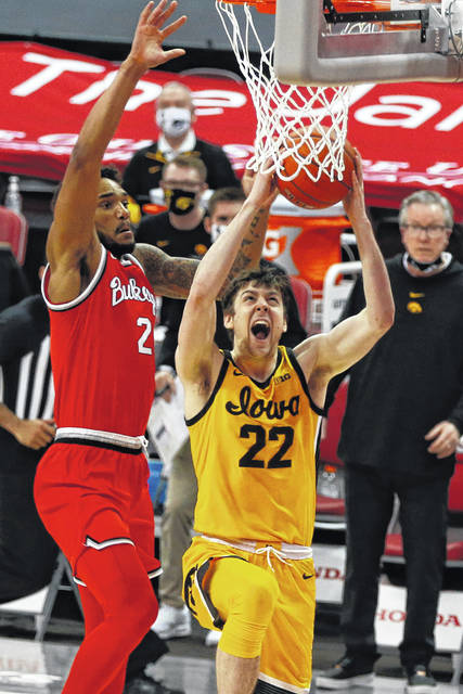 Iowa's Patrick McCaffery, right, shoots against Ohio State's Musa Jallow during the second half of an NCAA college basketball game Sunday, Feb. 28, 2021, in Columbus, Ohio. (AP Photo/Jay LaPrete)