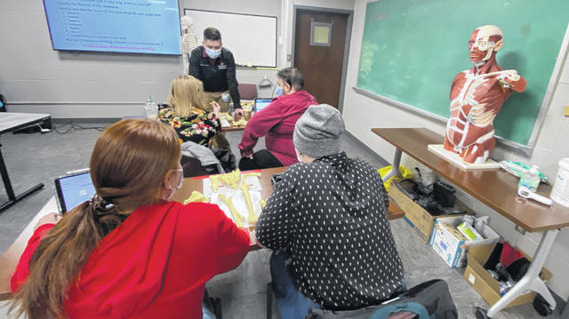 Ohio State students take part in an advanced anatomy lab at Mercy Health on Thursday evening.