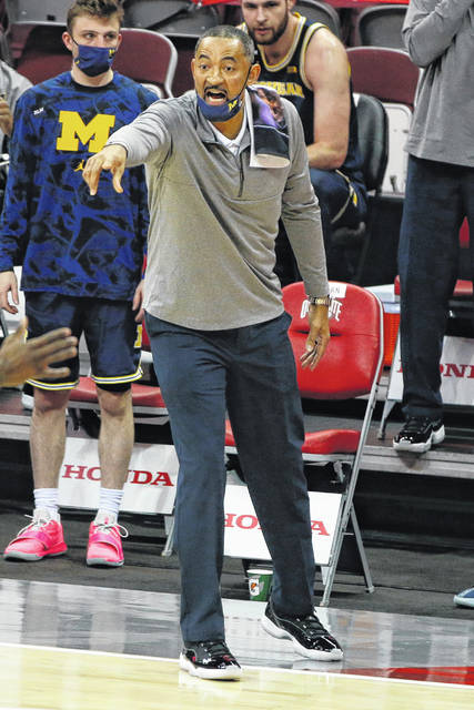 Michigan head coach Juwan Howard shouts to his team against Ohio State during the first half of an NCAA college basketball game Sunday, Feb. 21, 2021, in Columbus, Ohio. (AP Photo/Jay LaPrete)