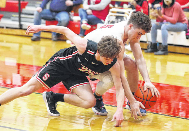 Spencerville's Tyler Koenig, left, tries to make the steal against Perry's Ryan Yingst during Friday night's Division IV sectional final at Perry. See more game photos at LimaScores.com.