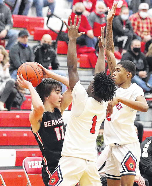 Perry's Terry Riley (1) and Will Knight pressure Spencerville's Dylan Smith during Friday night's Division IV sectional final at Perry.
