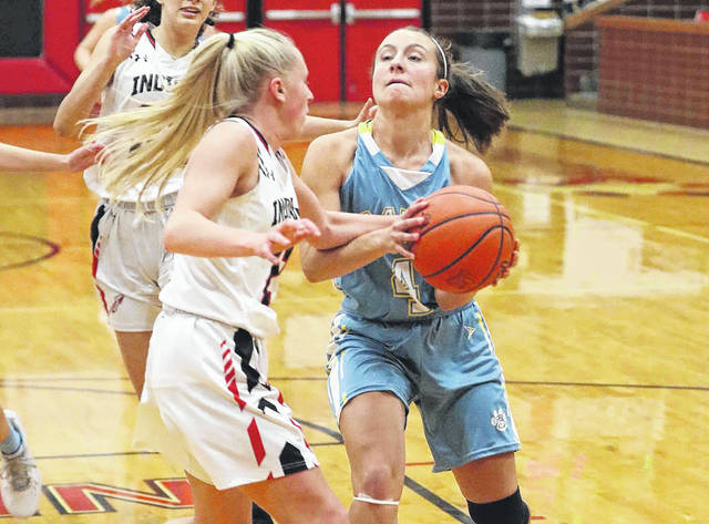 Shawnee girls basketball #21 Tessa Stahler tries to make the steal on Bath girls basketball #4 Abbie Dackin at Shawnee High School on December 3rd, 2020 more photos are available at limanews.com Photo By Don Speck